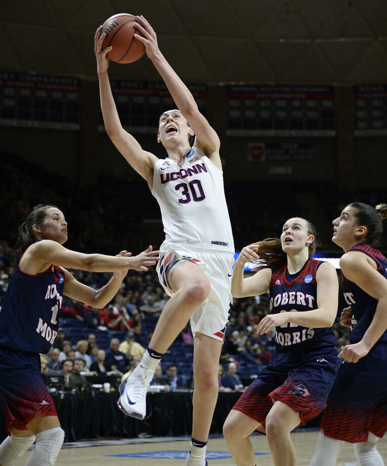 Connecticut's Breanna Stewart shoots over the defense of Robert Morris' Lou Mataly, left, Megan Smith, right center, and A Niki Stamolamprou, right, during a first round women's college basketball game in the NCAA Tournament, Saturday, March 19, 2016, in Storrs, Conn. (AP Photo/Jessica Hill)
