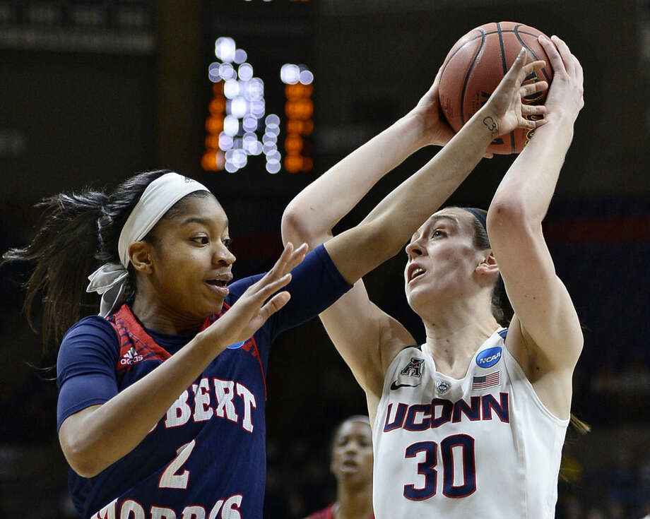Robert Morris' Nia Adams, left, fouls Connecticut's Breanna Stewart, right, during a first round women's college basketball game in the NCAA Tournament, Saturday, March 19, 2016, in Storrs, Conn. (AP Photo/Jessica Hill)