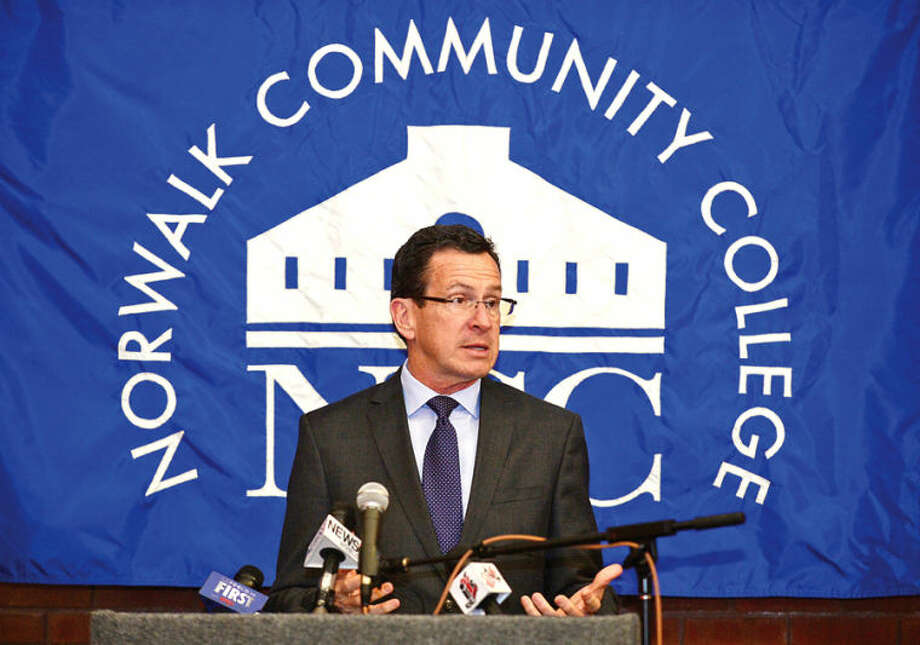 Hour photo / Erik Trautmann In this April 4, 2014 file photo, Governor Malloy announces a new educational initiative involving Norwalk Community College and Norwalk Public Schools at the college Friday. The Pathways in Technology Early College High School (P-TECH) intiative enables students to graduate with both a high school diploma and an Associates Degree in Applied Science through the college's Norwalk Early College Academy.