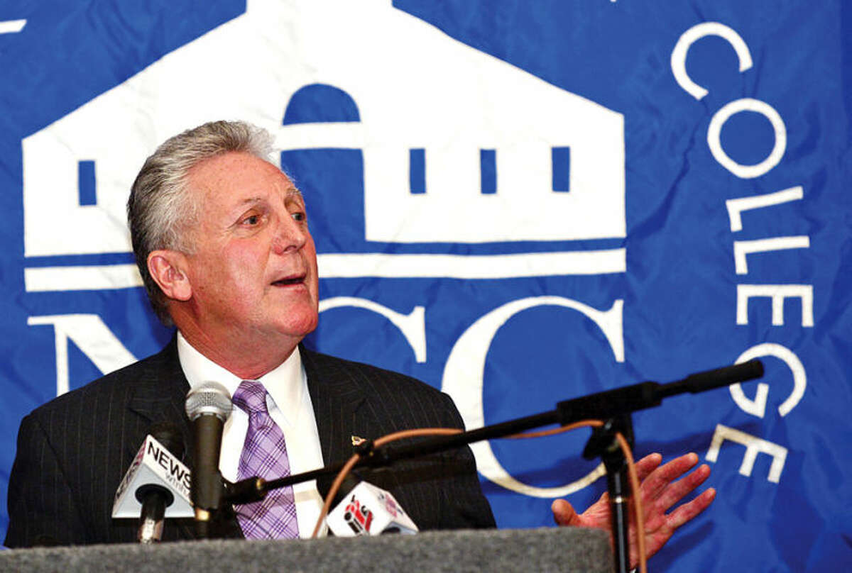Hour photo / Erik Trautmann Norwalk Mayor Harry Rilling comments on the new educational initiative involving Norwalk Community College and Norwalk Public Schools that CT Governor Malloy announced Friday. The Pathways in Technology Early College High School (P-TECH) intiative enables students to graduate with both a high school diploma and an Associates in Applied Science degree through the college's Norwalk Early College Academy.