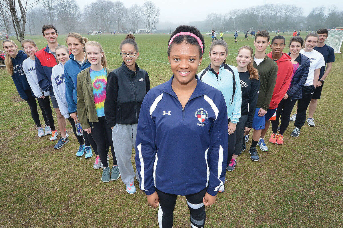 Green Farms Academy junior Olivia Sullivan, centered with the rest of the GFA team around her, brings a lot of experience to the first year track program.(Hour Photo/Alex von Kleydorff)