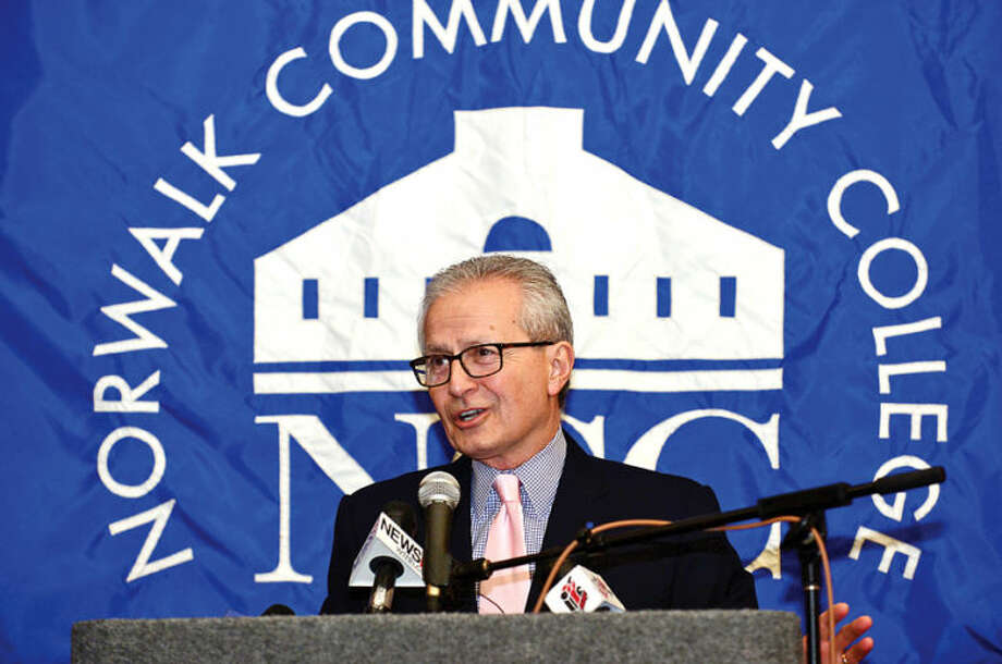 Hour photo / Erik Trautmann Chairman, the Board of Regents of Higher Education, Nick Donofrio, comments on the new educational initiative involving Norwalk Community College and Norwalk Public Schools that CT Governor Malloy announced at the college Friday. The Pathways in Technology Early College High School (P-TECH) intiative enables students to graduate with both a high school diploma and an Associates in Applied Science degree through the college's Norwalk Early College Academy.