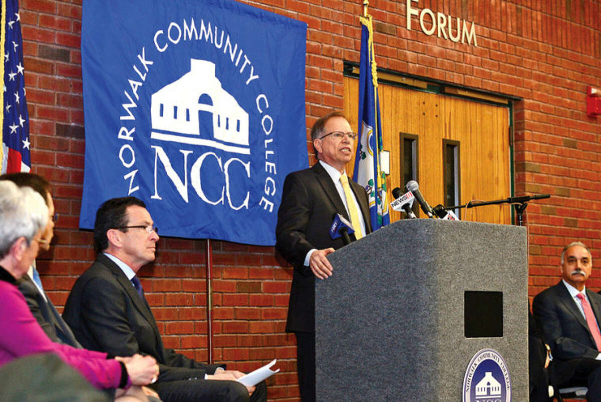 Hour photo / Erik Trautmann IBM Vice President of Corporate Citizenship and Corporate Affairs Stanley Litow comments on the new educational initiative involving Norwalk Community College and Norwalk Public Schools the CT Governor Malloy announced at the college Friday. The Pathways in Technology Early College High School (P-TECH) intiative enables students to graduate with both a high school diploma and an Associates in Applied Science degree through the college's Norwalk Early College Academy.