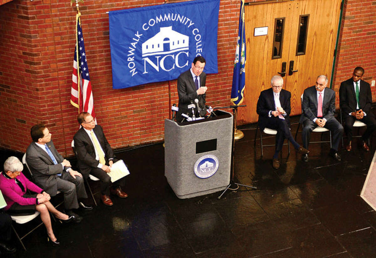 Hour photo / Erik Trautmann Governor Malloy announces a new educational initiative involving Norwalk Community College and Norwalk Public Schools at the college Friday. The Pathways in Technology Early College High School (P-TECH) intiative enables students to graduate with both a high school diploma and an Associates Degree in Applied Science through the college's Norwalk Early College Academy.