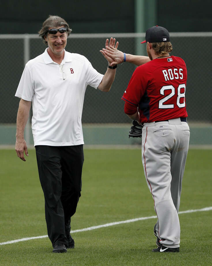 FILE - In this Feb. 25, 2015, file photo, Boston Red Sox mental skills coach Bob Tewksbury, left, greets starting pitcher Robbie Ross Jr., as they two pass each other on the field after a workout at baseball spring training in Fort Myers Fla. Long gone are the days when mental health was a taboo subject in major league locker rooms, and the days of a lone sports psychologist even appear to be waning. At least three teams _ the Cubs, Red Sox and Nationals _ announced major changes this year to their approach with mental health and skills. (AP Photo/Tony Gutierrez, File)
