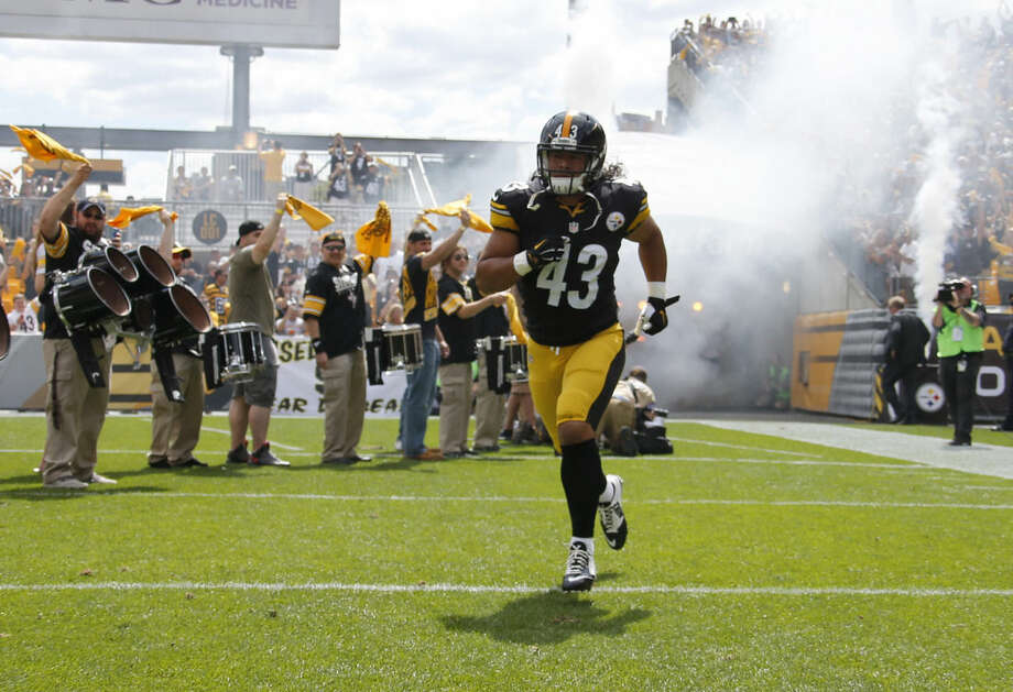 FILE - In this Sept. 7, 2014, file photo, Pittsburgh Steelers strong safety Troy Polamalu (43) takes the field during introductions for an NFL football game against the Cleveland Browns in Pittsburgh. Polamalu's iconic football career is over. The eight-time Pro Bowl safety told the Uniontown Herald-Standard he informed Steelers chairman Dan Rooney on Thursday night, April 9, 2015, he will retire rather than return for a 13th season. (AP Photo/Gene Puskar, File)