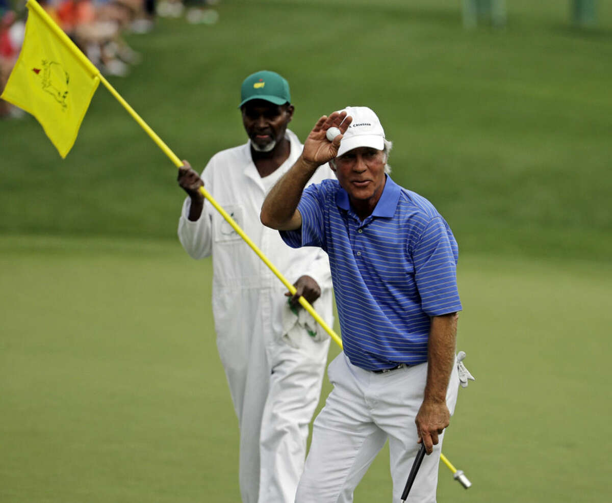 Ben Crenshaw walks to the 16th green with his caddie Justin Jackson during the second round of the Masters golf tournament Friday, April 10, 2015, in Augusta, Ga. (AP Photo/Darron Cummings)