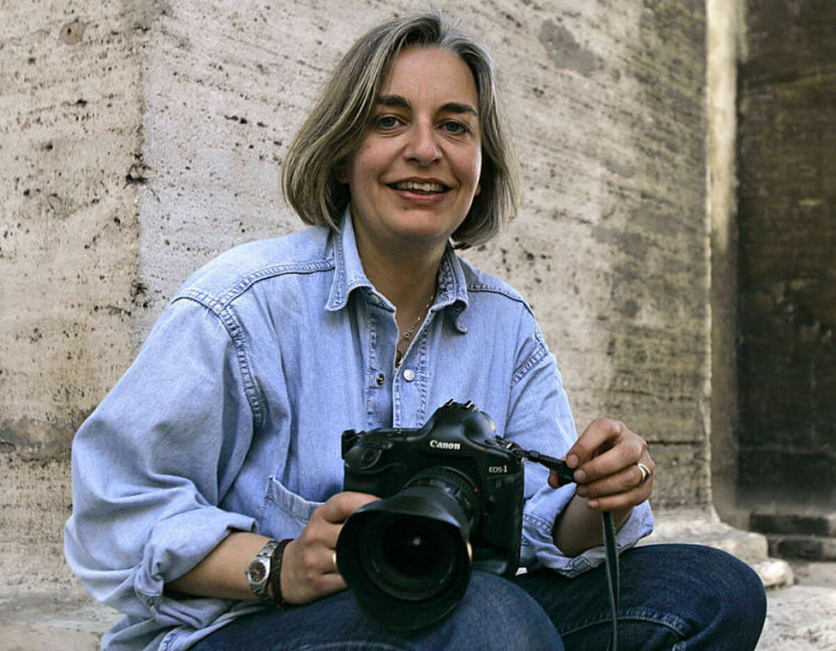 FILE - In this Thursday, April 2005 file photo, Associated Press photographer Anja Niedringhaus poses for a photograph in Rome. Niedringhaus, 48, was killed and an AP reporter was wounded on Friday, April 4, 2014 when an Afghan policeman opened fire while they were sitting in their car in eastern Afghanistan. Niedringhaus an internationally acclaimed German photographer, was killed instantly, according to an AP Television freelancer who witnessed the shooting. Kathy Gannon, the reporter, was wounded twice and is receiving medical attention. (AP Photo/Peter Dejong, File)