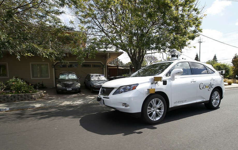 AP Photo/Tony Avelar, FileIn this Wednesday, May 13, 2015, file photo, Google's self-driving Lexus car drives along street during a demonstration at Google campus on in Mountain View, Calif. As Google cars encounter more and more of the obstacles and conditions that befuddle human drivers, the autonomous vehicles are likely to cause more accidents, such as a recent low-speed collision with a bus.