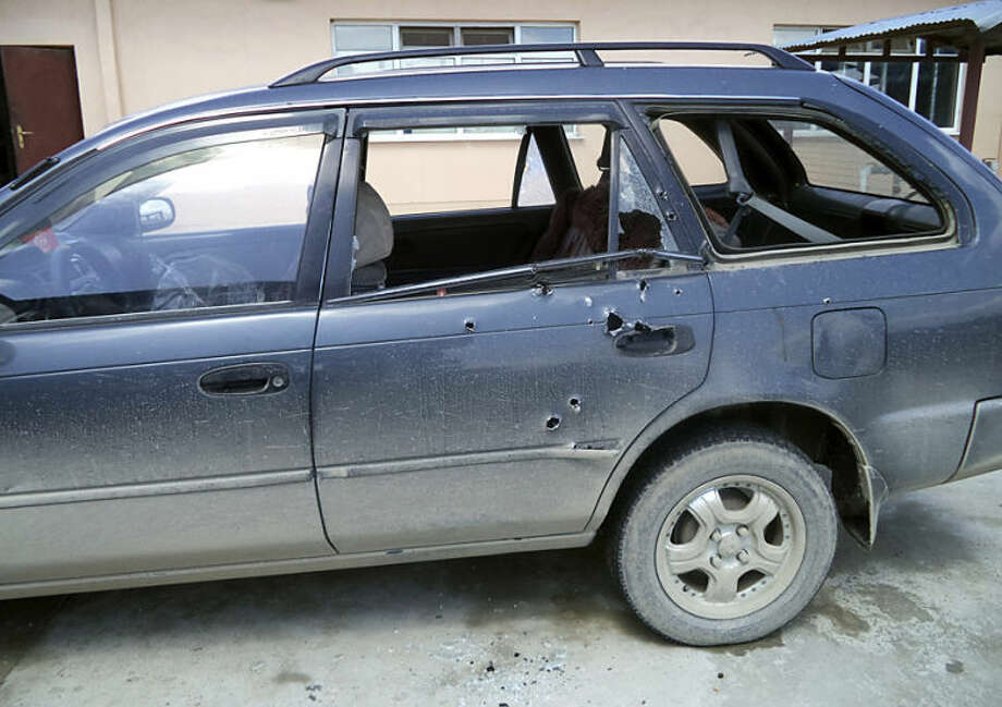 Bullet holes are seen in the car in which Associated Press photographer Anja Niedringhaus and AP reporter Kathy Gannon were traveling when they were shot by an Afghan policeman, Friday, April 4, 2014 in Khost, Afghanistan. Niedringhaus, 48, an internationally acclaimed German photographer, was killed instantly, according to an AP Television News freelancer who witnessed the shooting. Gannon was wounded twice and is receiving medical attention. (AP Photo)