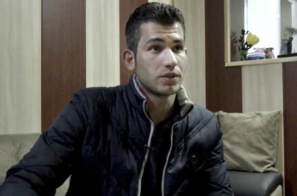 """In this Feb. 24, 2016 image made from AP video, Surkaw Omar, speaks during an interview with The Associated Press in Suleymaniya, Iraq. Omar quit his job and spent his life savings to migrate to Europe, only to find crowded asylum camps, hunger and freezing weather. Now back home in northern Iraq, he describes his quest for a better life as a disaster. """"It was very bad,"""" Omar, 25, said of the German camp. """"Honestly, we were starving there. We ran away because of hunger. They gave us only cheese and tea, and our weekly allowance was 30 euros."""" (AP Photo/Balint Szlanko)"""