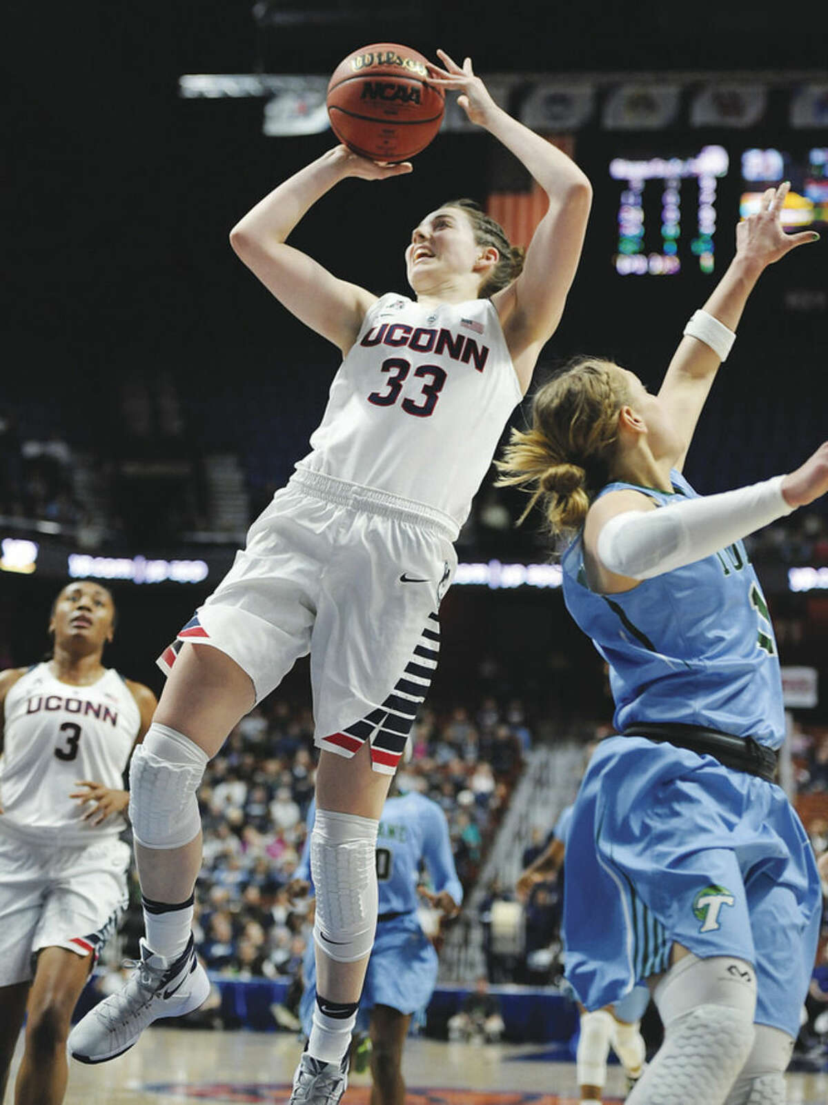 AP photo UConn's Katie Lou Samuelson (33) shoots past Tulane's Leslie Vorpahl during the first half of Sunday's American Athletic Conference tournament semifinal game at Mohegan Sun Arena in Uncasville. Samuelson, who is just a freshman, scored 17 points in the Huskies' 82-35 rout of the Green Wave.
