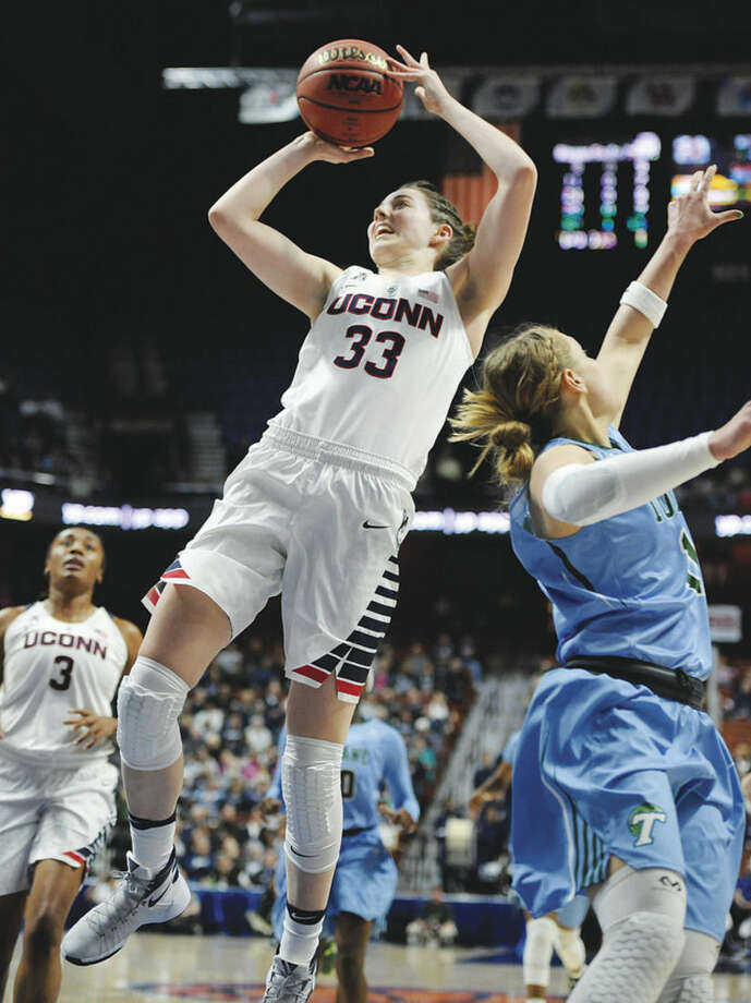 AP photoUConn's Katie Lou Samuelson (33) shoots past Tulane's Leslie Vorpahl during the first half of Sunday's American Athletic Conference tournament semifinal game at Mohegan Sun Arena in Uncasville. Samuelson, who is just a freshman, scored 17 points in the Huskies' 82-35 rout of the Green Wave.