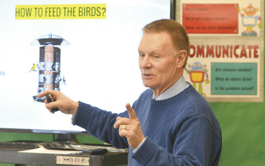 Hour Photo/Alex von Kleydorff All Saints School Teacher John Cook gives kids in his STEM program instructions on the workings of a bird feeeder, they are challenged to design and build a bird feeder using re pourposed objects such as water bottles