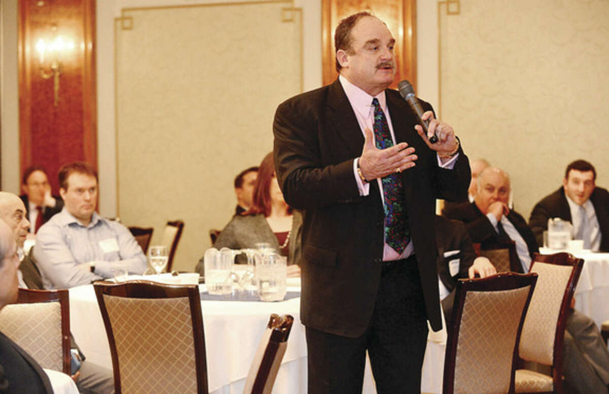 Hour photo / Erik Trautmann Chamber member Winthrop Baum asks questions of the panelist during the Greater Norwalk Chamber of Commerce presentation, Connecticut State Budget: Fact and Fiction, at the Norwalk Inn Tuesday morning.