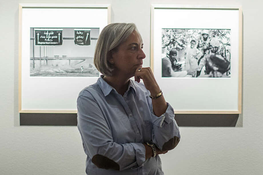 In this image taken Friday Sept. 11, 2011 AP photographer Anja Niedringhaus attends an exhibition of her work in Berlin. Niedringhaus, 48, was killed and an AP reporter was wounded on Friday, April 4, 2014 when an Afghan policeman opened fire while they were sitting in their car in eastern Afghanistan. Niedringhaus an internationally acclaimed German photographer, was killed instantly, according to an AP Television freelancer who witnessed the shooting. Kathy Gannon, the reporter, was wounded twice and is receiving medical attention. (Photo/Markus Schreiber)