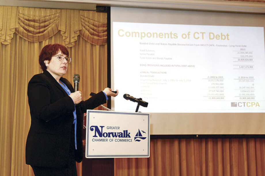 Hour photo / Erik Trautmann Julie McNeal, CPA and director of finance and operations for the Connecticut Society of CPAs and one of the featured panelists in the Greater Norwalk Chamber of Commerce presentation, Connecticut State Budget: Fact and Fiction, speaks at the Norwalk Inn Tuesday morning.