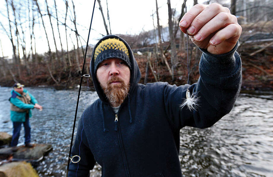 Hour photo / Erik Trautmann Local resident including Steve Snellman fish for trout on the Norwalk River in Wilton on Opening Day Saturday.