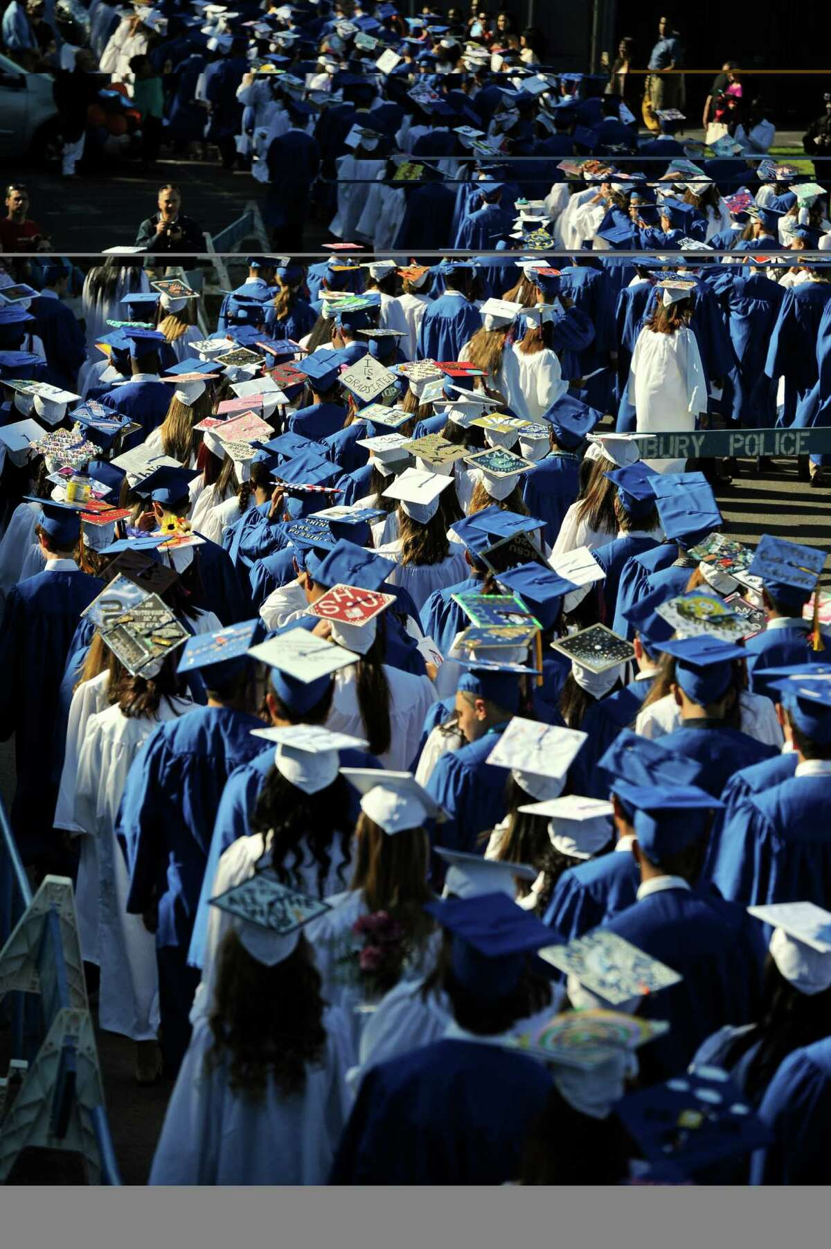 The Class of 2016 makes their way to the Danbury High School Stadium for the 2016 Commencement Exercises, held on Wednesday, June 9, 2016, in Danbury, Conn.