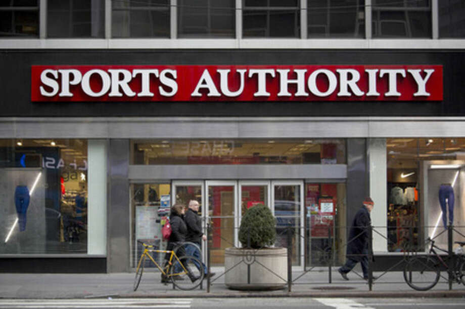 Pedestrians walk past a Sports Authority Inc. store in New York on Feb. 6. Sports Authority filed for bankruptcy Wednesday after failing to exploit the fitness boom that's been a rare bright spot in retail. MUST CREDIT: Bloomberg photo by John Taggart.