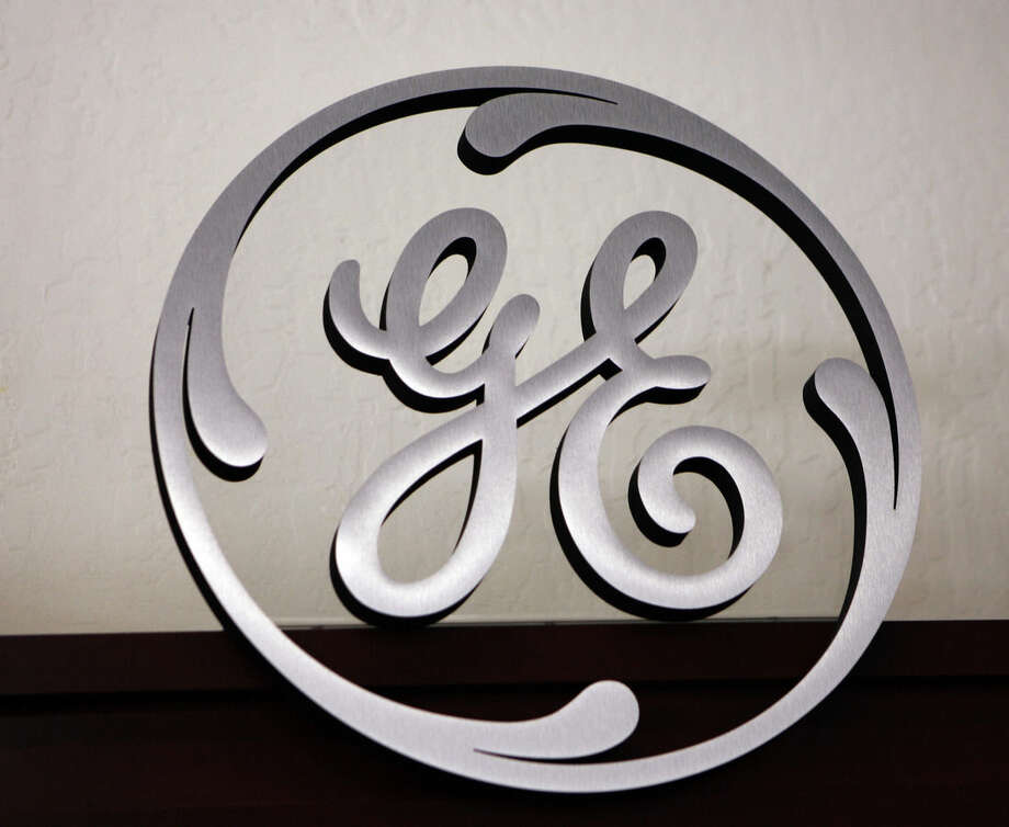 FILE - In this file photo taken Dec. 2, 2008, a General Electric (GE) sign is seen on display at Western Appliance store in Mountain View, Calif. General Electric will sell most of GE Capital as it turns its focus more to its industrial business and away from a big money generator that also made some investors nervous. The company will buy back as much as $50 billion of its own stock, sending shares up 6 percent before the opening bell Friday April 10, 2015 and toward a new high for the year. (AP Photo/Paul Sakuma, File)