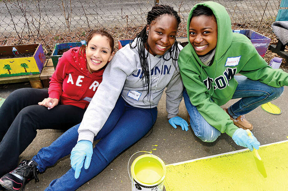 Hour photo / Erik Trautmann UCONN students Carolina Angel, Danielle Wilkinson and Shakyla Evans, volunteer with the Stamford Public Education Foundation (SPEF) park clean-up and rebuild at Cedar Street Park in Stamford's South End Saturday.