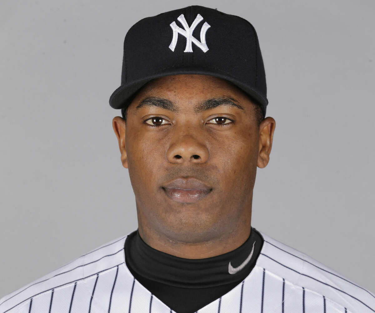 FILE - This is a 2016 file photo showing Aroldis Chapman of the New York Yankees baseball team. Aroldis Chapman agreed to accept a 30-game suspension under Major League Baseball's domestic violence policy, a penalty stemming from an incident with his girlfriend last October. Under the discipline announced Tuesday, March 1, 2016, Chapman will serve the penalty from the start of the season in April. (AP Photo/Chris O'Meara, File)