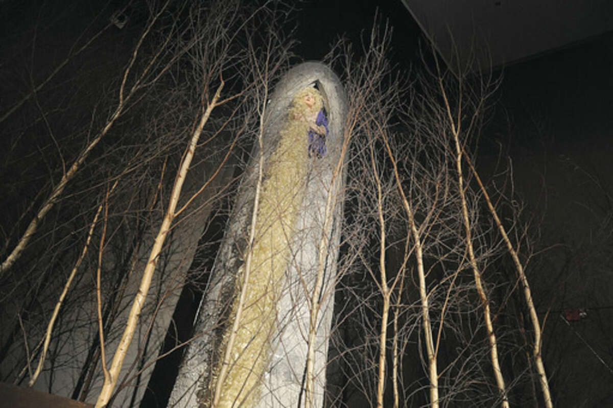 """Hour photo/Matthew Vinci Grace Deloe as Rapunzel performs Tuesday night in a dress rehearsal for Brien McMahon High School's performance of """"Into the Woods."""""""