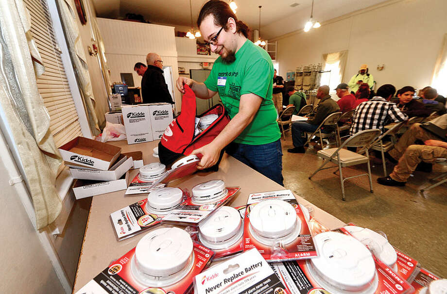 Hour photo / Erik Trautmann Norwalk Amatuer Radio Club president Sam Dick join The Norwalk Fire Department and American Red Cross as they sponsor a fire safety campaign Saturday where teams made up of City Fire department staff, Public Safety cadets, and Red Cross volunteers train to go door-to-door in the South Norwalk area to install new smoke detectors in homes and perform home fire safety checks.