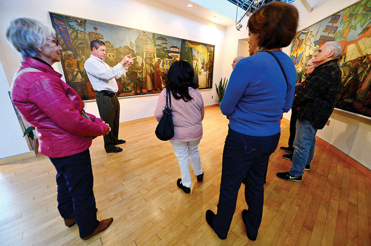 Hour photo / Erik Trautmann WPA docent, Richard Wenzel, guides a tour of rarely seen paintings created by Arthur Gibson Hull during Slow Art Day sponsored by The Norwalk Arts Commission and the Norwalk Transit District Saturday at the Transit District Headquarters on Wilson Ave. in Norwalk.