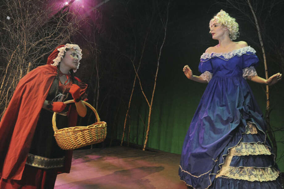 """Hour photo/Matthew VinciSophie Starknan as Little Red Riding Hood and Amanda Mariano as Cinderella's stepmother perform in a dress rehearsal for Brien McMahon High School's play """"Into the Woods."""""""