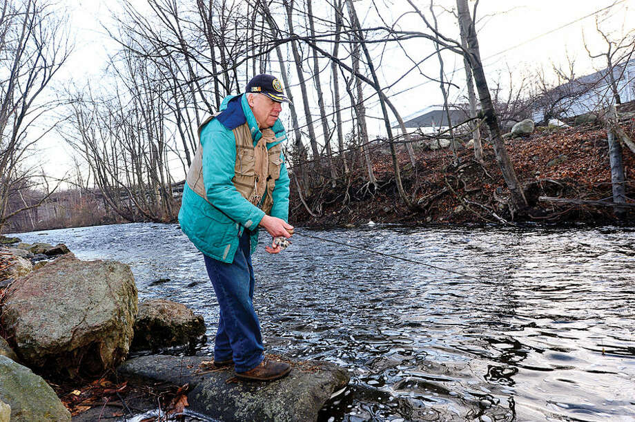 Hour photo / Erik Trautmann Local resident including Bill Geils fish for trout on the Norwalk River in Wilton on Opening Day Saturday.
