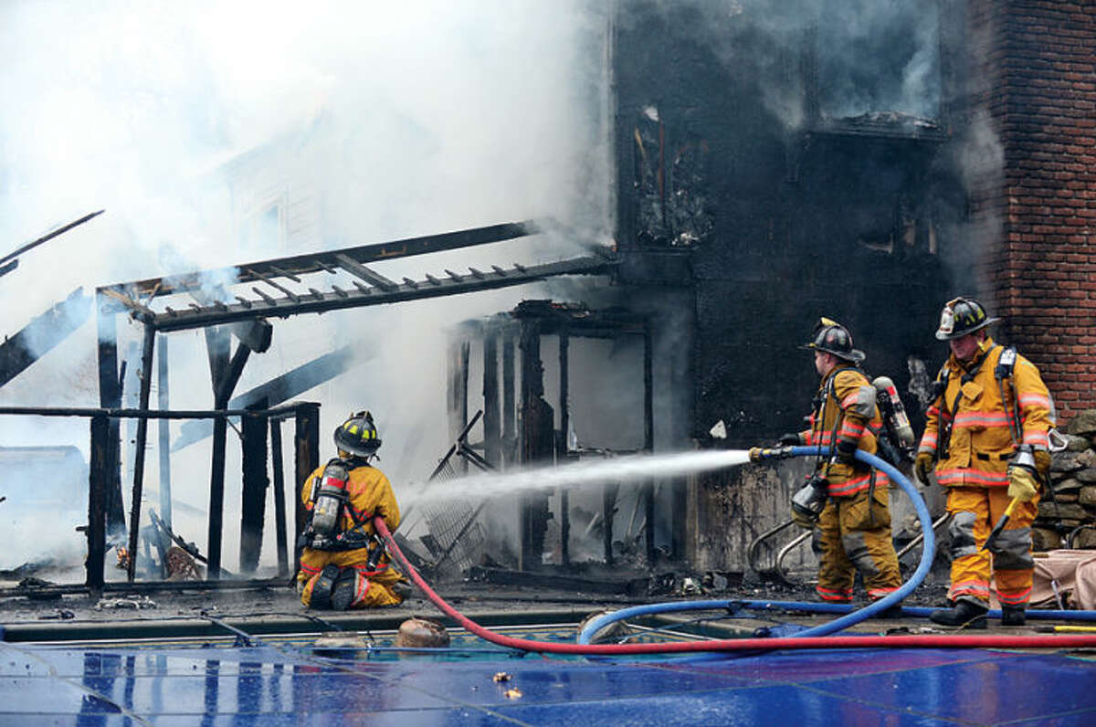 Wilton and Weston fire departments respond to a house fire at 211 Linden Tree Road. in Wilton Saturday morning.