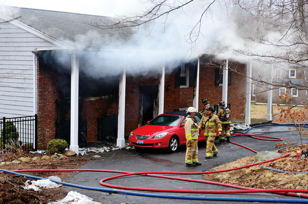 Wilton and Weston fire departments respond to a house fire at 211 Linden Tree Road in Wilton Saturday morning.