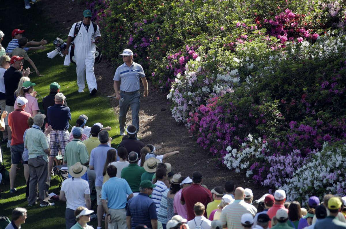Charley Hoffman walks down the sixth fairway during the third round of the Masters golf tournament Saturday, April 11, 2015, in Augusta, Ga. (AP Photo/Matt Slocum)