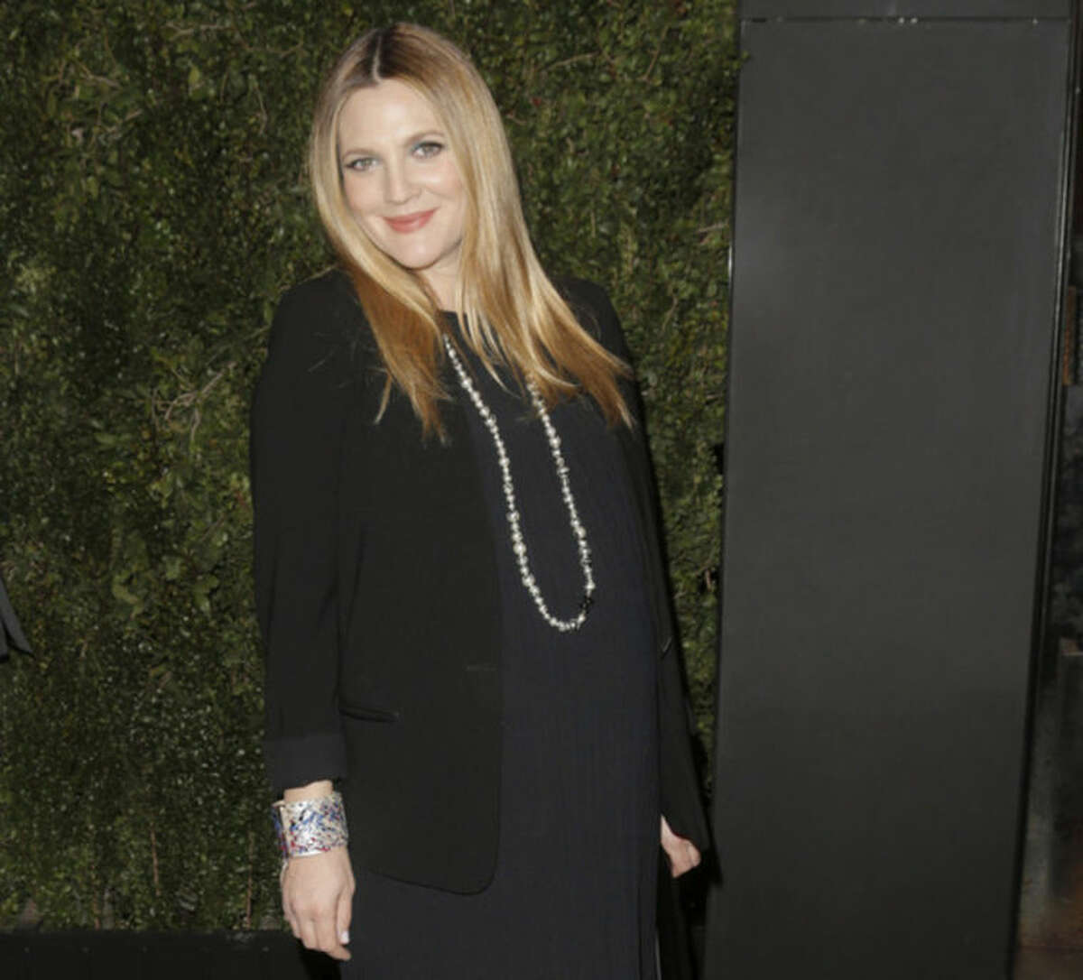 """FILE - In this Jan. 14, 2014 file photo, Drew Barrymore arrives at the Chanel Dinner celebrating the release of Drew Barrymore's new book """"Find It In Everything"""" at the Chanel Boutique in Beverly Hills, Calif. The 39-year-old, who is expecting her second daughter with husband Will Kopelman any day now, is joining other famous families at Safe Kids Day, an educational playdate that raises funds and awareness of preventable childhood injuries. Gwen Stefani and Gavin Rossdale, Mark Wahlberg, Piers Morgan, Kelsey Grammer and Ciara are among the celebrities expected at the Los Angeles event Saturday, April 5, 2014. (Photo by Todd Williamson/Invision/AP, file)"""