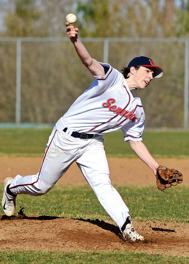 Hour photo / Erik Trautmann Brien McMahon #10 pitches against Norwalk High Schooln their intra city baseball game at Brien McMahon High School Saturday.