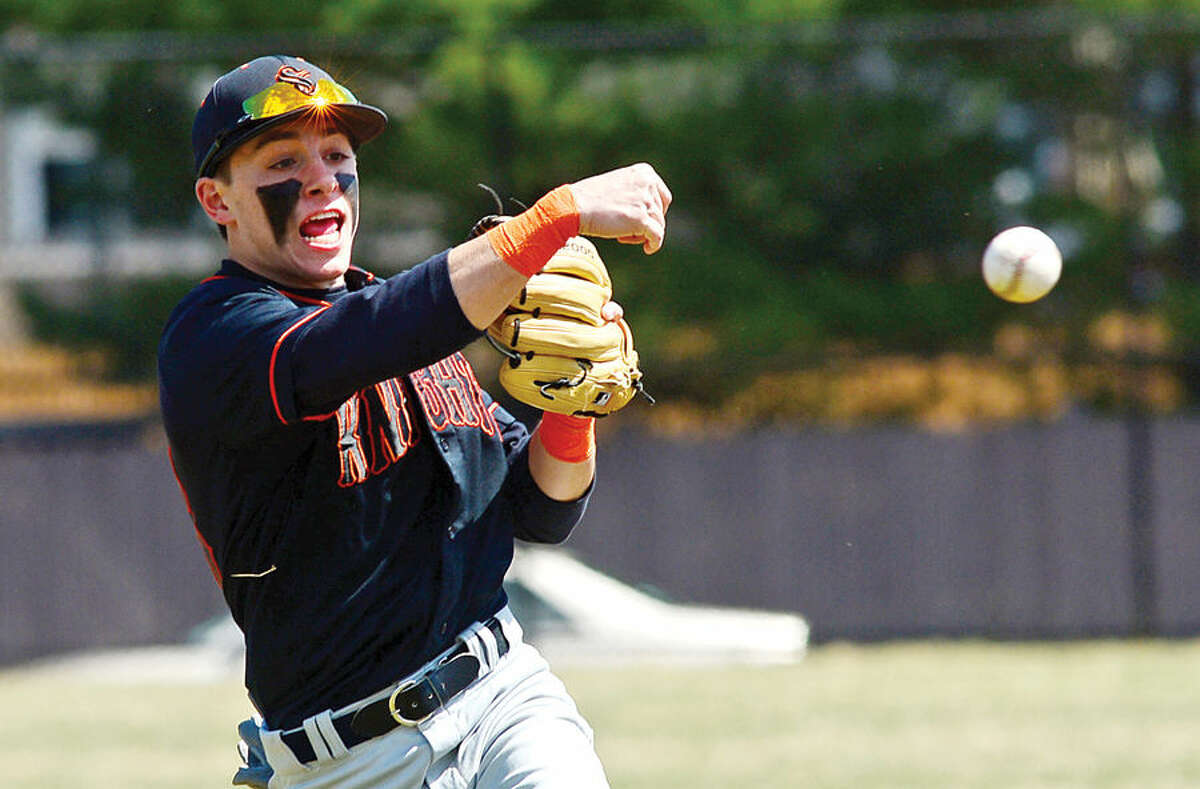 Hour photo / Erik Trautmann Stamford High's #26 second baseman throws to first during their game against Trnity Catholic Saturday.