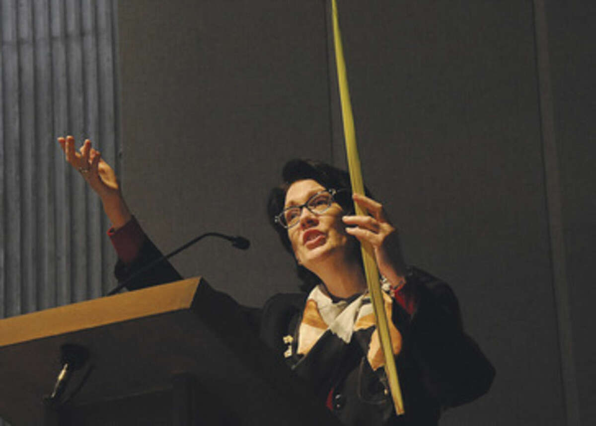 Mary Bauer leads a hymn at St. Phillip Church in Norwalk at the Palm Sunday service. Hour photo/Matthew Vinci