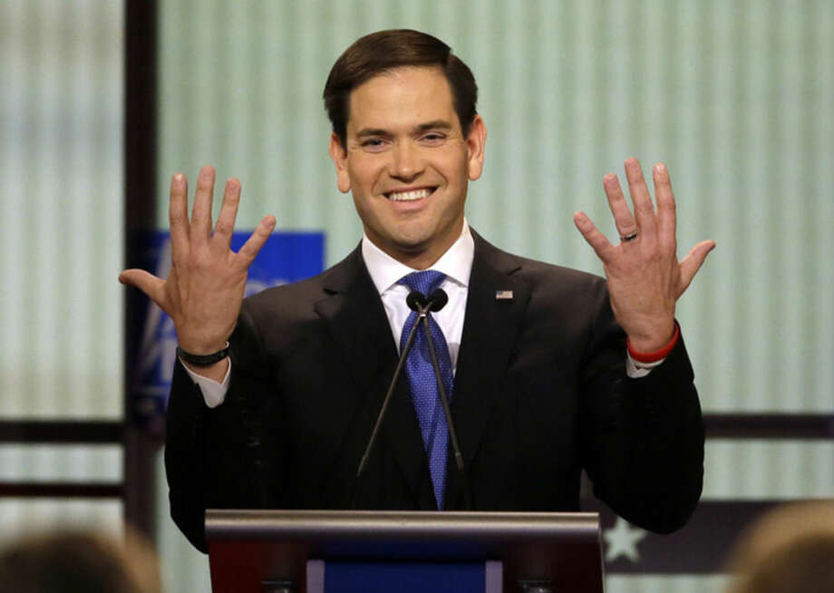 Republican presidential candidate, Sen. Marco Rubio, R-Fla., gestures during a Republican presidential primary debate at Fox Theatre, Thursday, March 3, 2016, in Detroit. (AP Photo/Carlos Osorio)