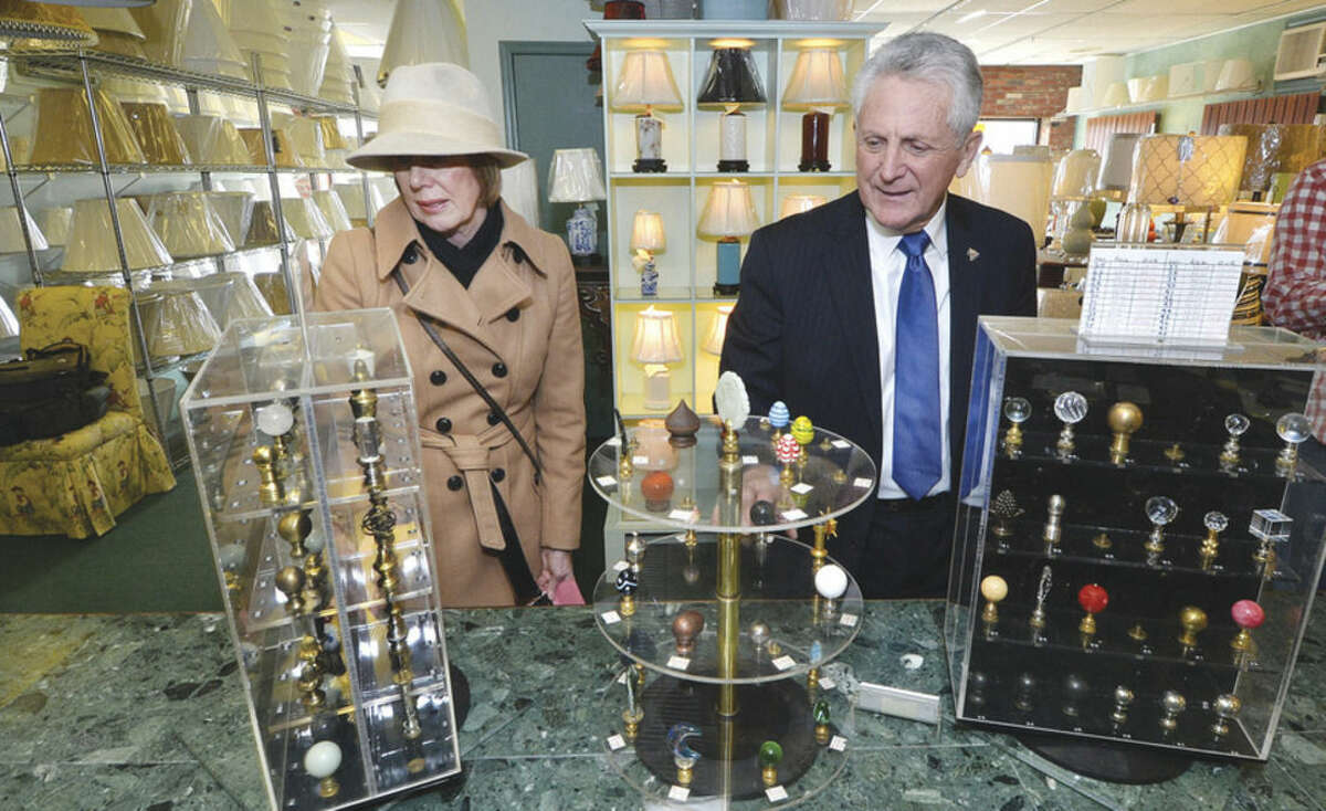 Hour Photo/Alex von Kleydorff Liz Stocker, Director of Business Development and Mayor Harry Rilling look at some of the Finials offered at The Lamp Shade Store