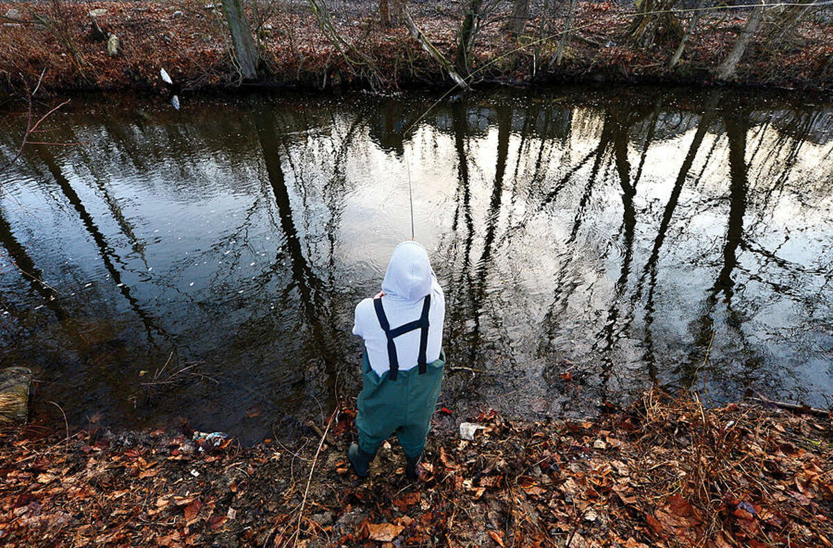 Hour photo / Erik Trautmann Local resident including Alex Lametta fish for trout on the Norwalk River in Wilton on Opening Day Saturday.