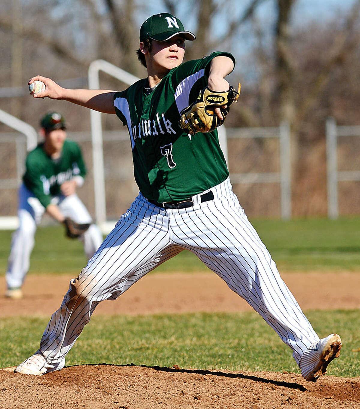 Hour photo / Erik Trautmann Norwalk High School's #7 Mike Gonzalez pitches in their intra city baseball game against Brien McMahon High School Saturday.