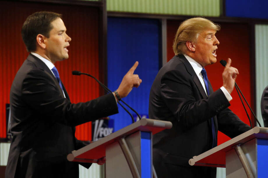 Republican presidential candidates, Sen. Marco Rubio, R-Fla., and businessman Donald Trump argue during a Republican presidential primary debate at Fox Theatre, Thursday, March 3, 2016, in Detroit. (AP Photo/Paul Sancya)