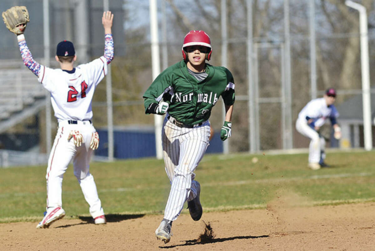 Hour photo/Erik Trautmann Norwalk High's Mo Ortiz rounds second base on his way to third during Saturday's intra-city baseball game against Brien McMahon. The Bears came out on top over the Senators, 11-3.