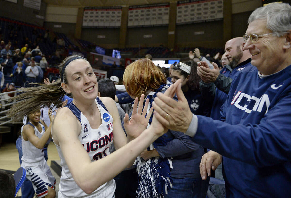 Connecticut's Breanna Stewart greets fans at the end of a first round women's college basketball game against Robert Morris in the NCAA Tournament, Saturday, March 19, 2016, in Storrs, Conn. UConn won 101-49. (AP Photo/Jessica Hill)