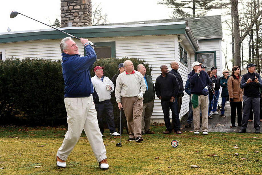 Hour photo / Erik Trautmann Norwalk mayor Harry Rlling hits the ceremonial first ball to usher in the official golf season at Oak Hills Park Saturday.