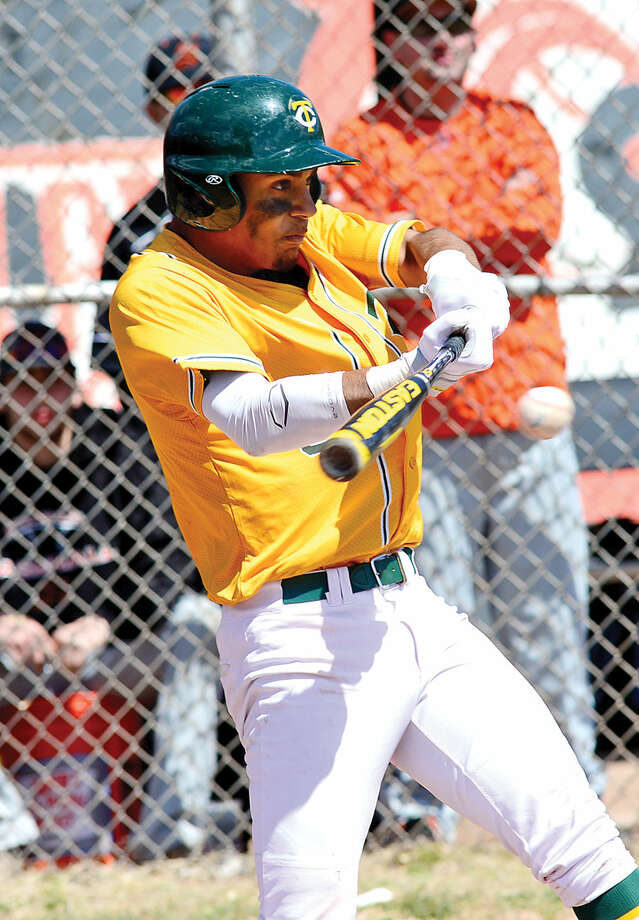 Hour photo / Erik Trautmann Trinity Catholic's #3 Randy Polonia hits one of his RBIs during their game against Stamford High Saturday.