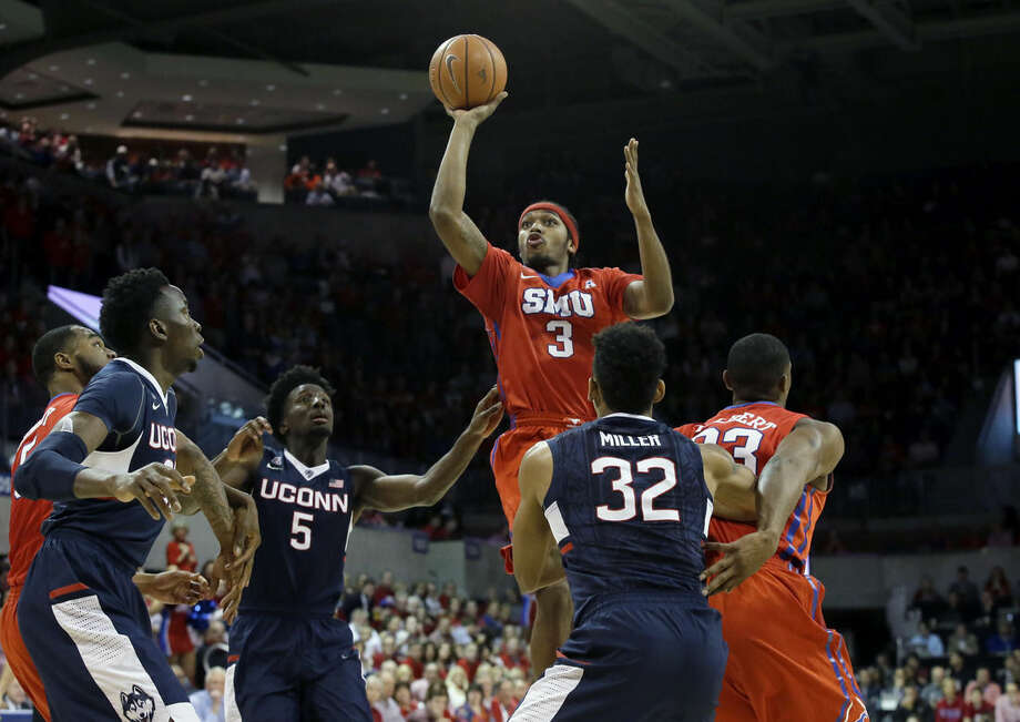 SMU guard Sterling Brown (3) shoots over traffic during the first half an NCAA college basketball game against Connecticut on Thursday, March 3, 2016, in Dallas. Looking on are Connecticut's Daniel Hamilton (5), Shonn Miller (32) and Steven Enoch and SMU's Jordan Tolbert, right, and Markus Kennedy. (AP Photo/LM Otero)