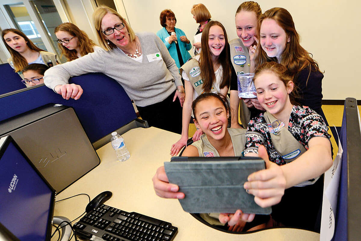 Hour photo / Erik Trautmann A group of Girl Scouts and theirmentor Denise Stevens, President of Matrix Public Health Solutions, take a selfie for their project as The International Womens Forum of Connecticut hosts the scouts at the UCONN School of Business in Stamford for an interactive workshop focused on STEM (Science Technology Engineering and Math) featuring the solar powered Luci Light. The girlscouts worked with leading executive women from across the state to form product development and marketing strategies for an enhanced Luci Light.